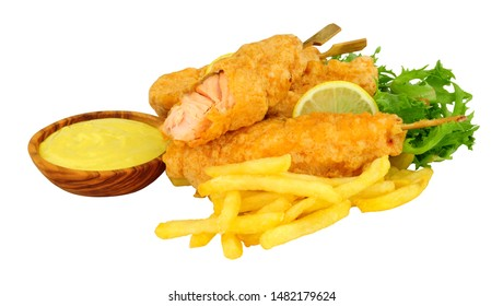 Battered salmon fish fillets on wooden skewers with French Fries with a wooden bowl of mayonnaise isolated on a white background