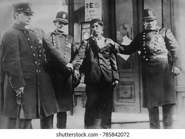 Battered striker with policemen during the Philadelphia Trolley Strike, Feb. 24, 1910. 29 people died and nearly one thousand street cars were destroyed during the strike