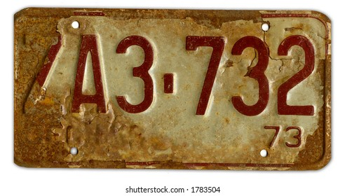 a battererd worn grungy rusty number plate