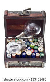 Batteries energy for a big or small  idea concept shot. Opened treasure chest with batteries and bulb lamps inside isolated on white/Energy for ideas