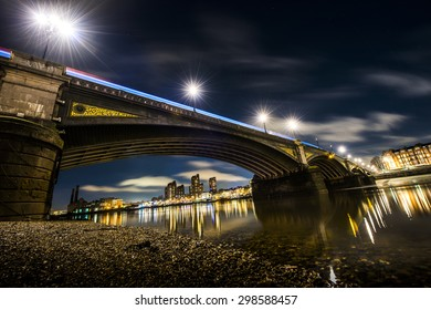 Battersea bridge, London, as seen from the south bank of the Thames river, at night time