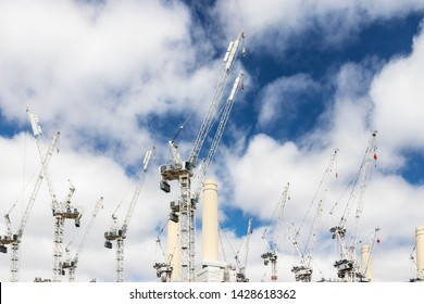 BATTERSEA, WANDSWORTH, SOUTH WEST LONDON, UNITED KINGDOM – May 26, 2019: Tower cranes over the Battersea Power Station redevelopment.