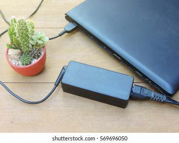battery charge on laptop computer with power plug,laptop battery charger adapter of notebook.