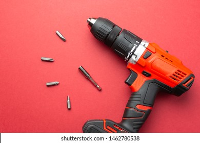 Battery drill on a red background