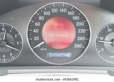 Battery low red light icon on car dashboard