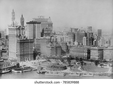 Battery Park and the Financial District in aerial photo taken from a U.S. Army plane, c. 1920. View includes three towers: 26 Broadway , Singer Tower, and Woolworth Building