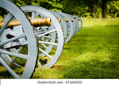 Battery of revolutionary cannons displayed at Valley Forge National Park. Antique Cannons in green grass.