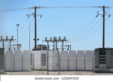 Battery storage at Solar Farm with Switchgear or switch gear in background.