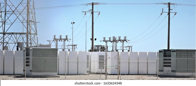 Battery storage at a Solar Farm with switchgear or switch gear in the background