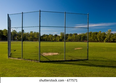 A batting cage at a small park