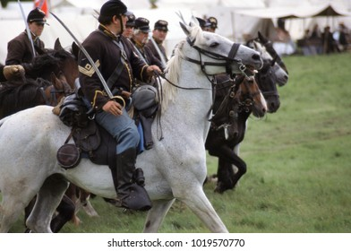 Battle Abbey Sussex England 1996. Mounted Union cavalry prepare to charge sabre's in hand at a re-enactment event of the American Civil War.
