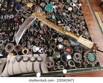 Battle folding sickle from Afghanistan called lohar, Khyber pass war weapon of Pashtun people lying on a shop window with souvenirs