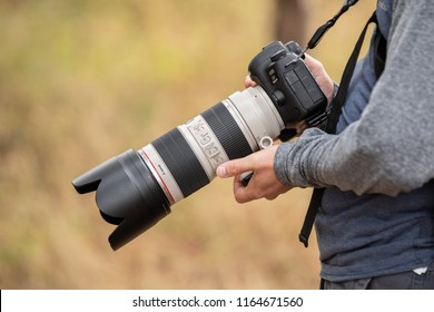 Battle Ground, WA / USA - August 25 2018: Male person holding Canon 5D Mark IV with 70-200 lens.