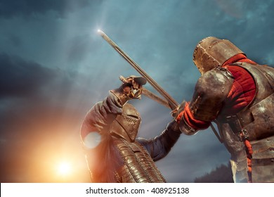 Battle of a Medieval knights on the sunset background.