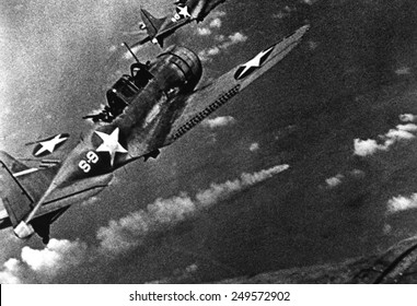Battle of Midway, June 4-6, 1942. U.S. Douglas SBD-3 Dauntless dive bomber from the USS Hornet continues the attack on the burning Japanese cruiser Mikuma, June 6, 1942.