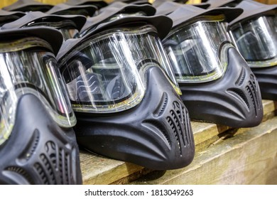 Battle paintball helmets with pieces of paint  ready for next game