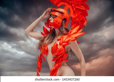Battle, Roman warrior with helmet of feathers and horse mane. She is wearing a red dragon scales, fantasy pose