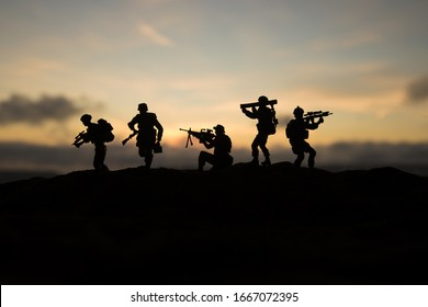 Battle scene. Military silhouettes fighting scene on war fog sky background. World War Soldiers Silhouettes Below Cloudy Skyline At sunset. Artwork Decoration. Selective focus