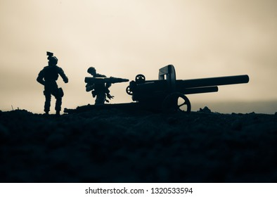 Battle scene. Silhouette of old field gun standing at field ready to fire. Creative artwork decoration. Selective focus