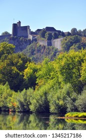 The battlements of the Citadel of Besançon seen from the Micaud public park with the Doubs River in the foreground