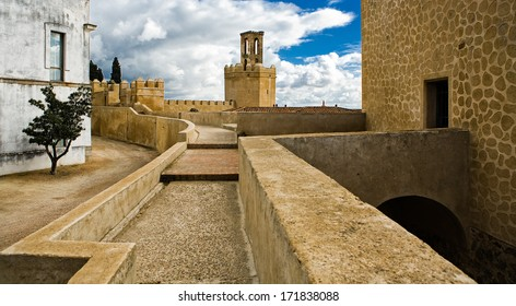 Battlements, pathways and towers of Badajoz muslim wall. Adarve and inside buildings, Spain