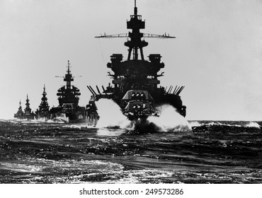 Battleship USS Pennsylvania is followed by three cruisers. They enter the Lingayen Gulf to support the U.S. Invasion of Luzon Island. Jan. 1945. Philippines, Pacific Ocean, World War 2.