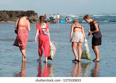 Batu Bolong Beach, Canggu, Bali / Indonesia - April 20 2019: People are picking up trash on the beach for 2019 Beach Clean Up event in Canggu.