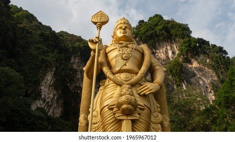 The Batu Caves Lord Murugan Statue and entrance near Kuala Lumpur Malaysia. A limestone outcrop located just north of Kuala Lumpur, Batu Caves has three main caves featuring temples and Hindu shrines.