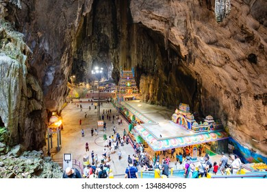 BATU CAVES, MALAYSIA - 23 March 2019: The popular tourist attraction of Batu Caves which are sacred Hindi limestone caves near Kuala Lumpur, Malaysia