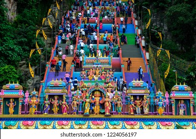 BATU CAVES, MALAYSIA – 8 November 2018: The famous and iconic limestones with new rainbow painting at Batu Caves. The cave is the focal point of Hindu festival of Thaipusam and Deepavali in Malaysia.