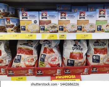 BATU CAVES, MALAYSIA - JUNE 13, 2019 :  Assorted packs of instant oat meal brand QUAKER in the supermarket