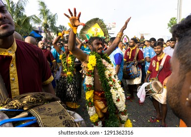 BATU CAVES, MALAYSIA-January 21, 2019: A celebration and devotee carrying kavadi preparing for ceremony prayers blessings during Thaipusam festival. Image contain certain grain or noise and soft focus