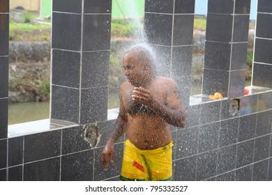 Batu Caves, Selangor - February 8th 2017 : Malaysian Hindu devotees bathing before they start their ritual for celebrating Thaipusam Festival at Batu Caves, Selangor.