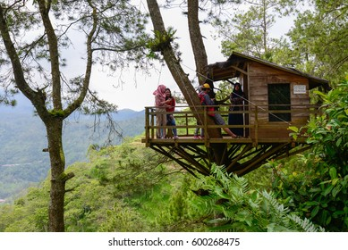 Batu, Indonesia - February 26, 2017: Omah Kayu, a trending recreational area on top of Gunung Batu Banyak which is famous for various tree-house buildings in this forest, in Malang, Indonesia.
