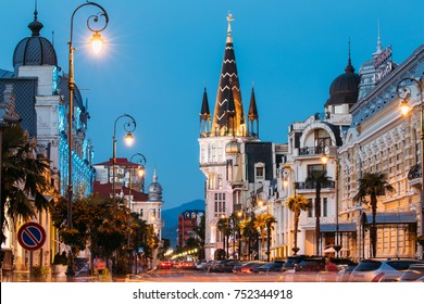 Batumi, Adjara, Georgia. Evening View On Former National Bank Building With Astronomical Clock On Europe Square.