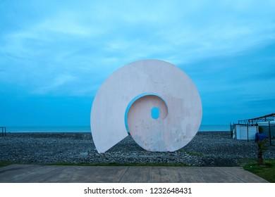 "BATUMI, ADJARA, GEORGIA - MARCH 18: ""L'Arobase"" snail sculpture by French artist Emile Laugier on March 18, 2018 in Batumi. The sculpture is installed on Batumi Seaside Boulevard."