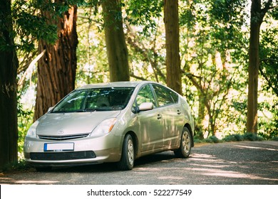 Batumi, Adjara, Georgia - May 27, 2016: Toyota Prius is a full hybrid electric automobile car is parked on country road in forest. Prius is world's top selling hybrid car with 3.73 million units sold