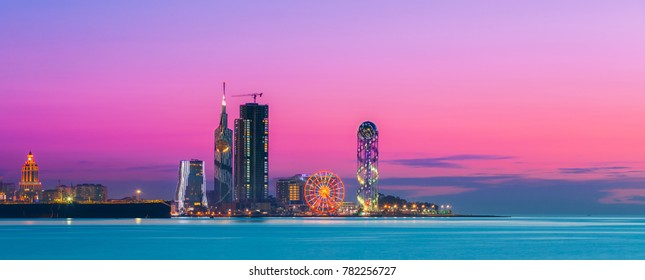 Batumi, Adjara, Georgia. Panorama of Illuminated Resort Town at Sunset.