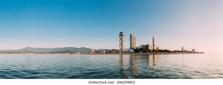 Batumi, Adjara, Georgia. Panorama Modern Architecture In Seafront Promenade. Miracle Park In Sunny Day. View From Sea To Resort Town Cityscape With Skyscrapers And Alphabet Tower.