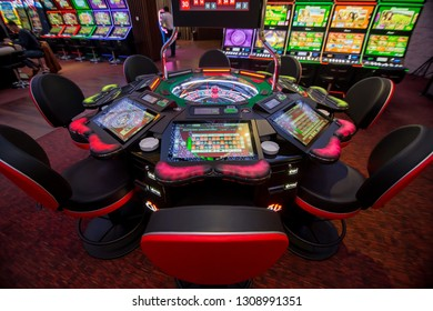 Batumi, Adjaria / Georgia - 01.25.2019: Gambling table with electronic roulette in a Casino. Casino hall with slots and roulette.