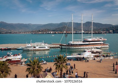 BATUMI, GEORGIA- April 1, 2018: People and ships in the Batumi port marina