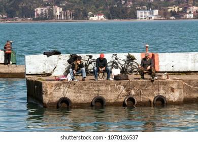 BATUMI, GEORGIA- April 1, 2018: Fishermen catching the fish in Batumi port.