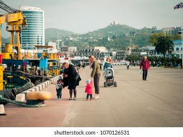 BATUMI, GEORGIA- April 14, 2018: People walking and having on Batumi boulevard.