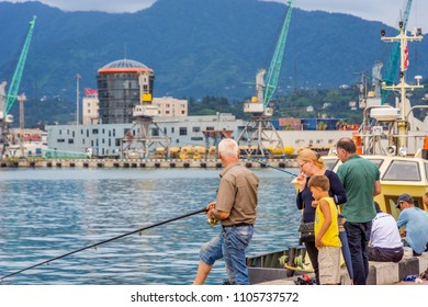 Batumi, Georgia - August 25, 2017: People fishing from the pier on the center of Batumi.