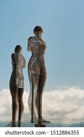 """Batumi, Georgia - August 26 2019: The moving metal love monument """"Ali&Nino"""" in Batumi. Figures are moving towards each other merging into a single entity, without touching."""