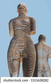 """Batumi, Georgia - August 26 2019: Closeup of the moving metal love monument """"Ali&Nino"""" in Batumi. Figures are moving towards each other merging into a single entity, without touching."""