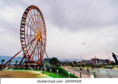 BATUMI, GEORGIA - August 6, 2016: Batumi ferris wheel with cloudy sky in the evening time in Adjara, Georgia