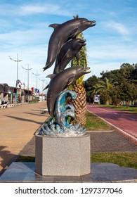 BATUMI, GEORGIA- January 11, 2019: Traveling in beautiful modern Batumi.Batumi boulevard.Dolphins monument. Georgia