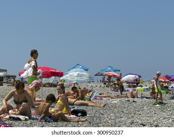 BATUMI, GEORGIA - JULY 20, 2015: Unidentified people on the beach of Batumi. With a population of 190,000 Batumi serves as an important port and a commercial center.