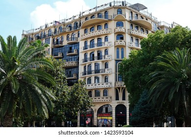 BATUMI, GEORGIA - June 5, 2019: Beautiful building on the street Zurab Gorgiladze, on the first floor of the house are shops. Upper floors are rented. Original architecture in Batumi